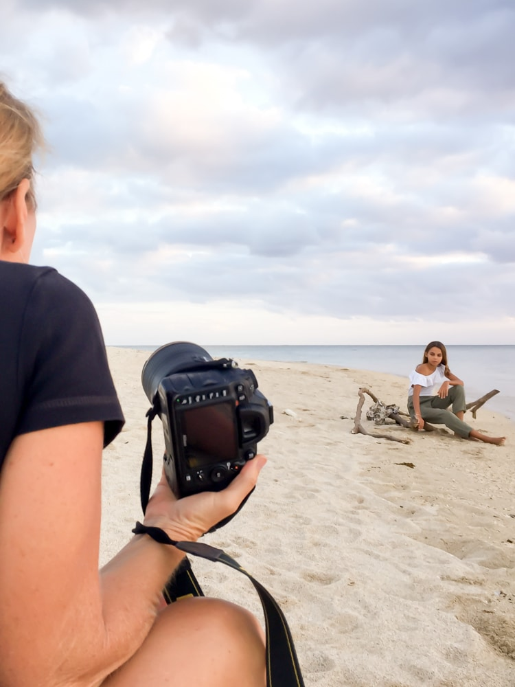 photographer photographing client on the beach