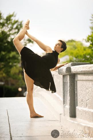 Dancer stretches for Ann Arbor dance photographer Natalie Mae.