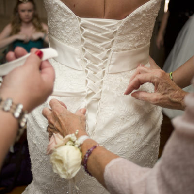 Lacing up bride's dress - Ann Arbor, Michigan Wedding Photographer