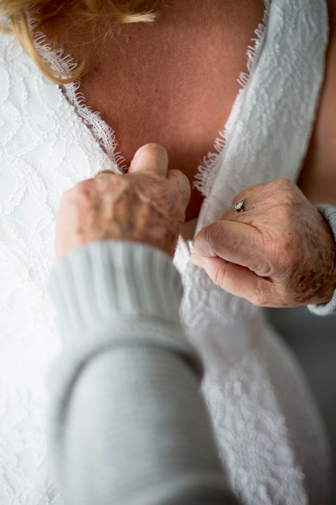 Mom helps bride zip up her dress before her Chelsea Michigan elopement