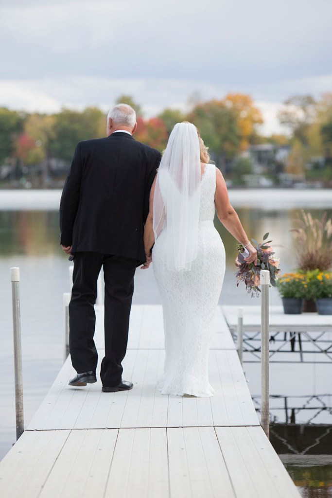 Couple walks towards the end of the dock