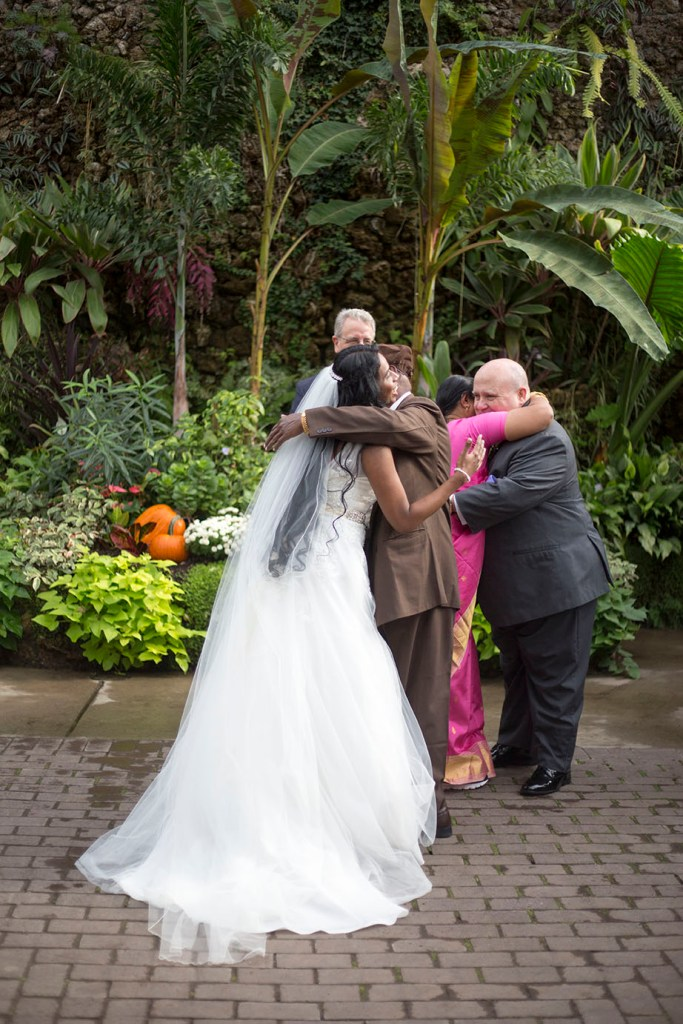 Parents giving away their daughter at their Detroit wedding