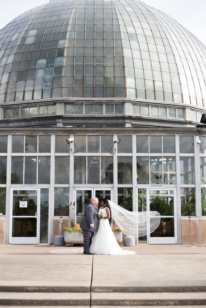 Wedding couple outside of Belle Isle Conservatory