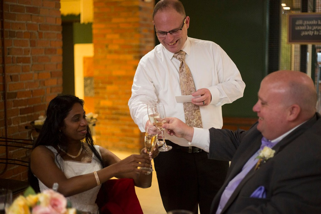 Bride and groom toasts the best man