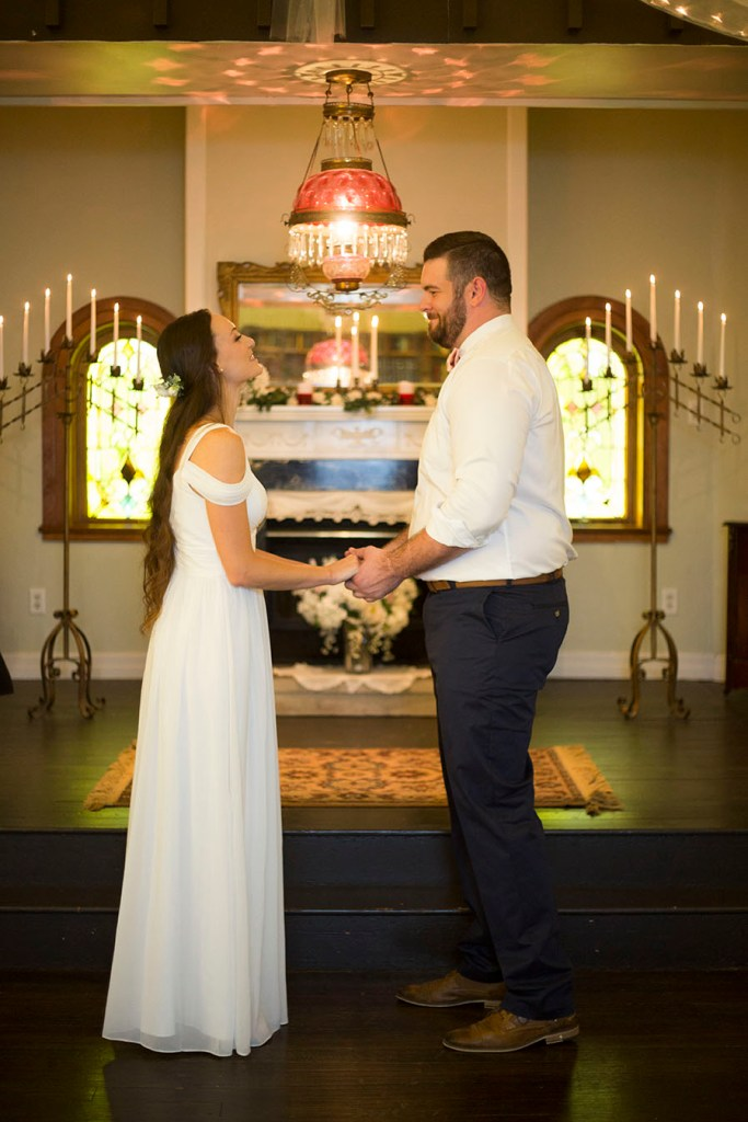 The couple standing at the altar in Celebrations Wedding Chapel