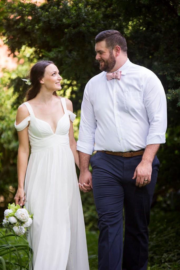 Couple walking in the gardens of Celebrations Wedding Chapel