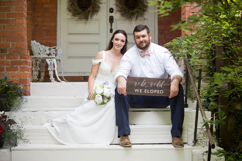 Michigan wedding couple sits on steps outside of chapel in Horton Michigan