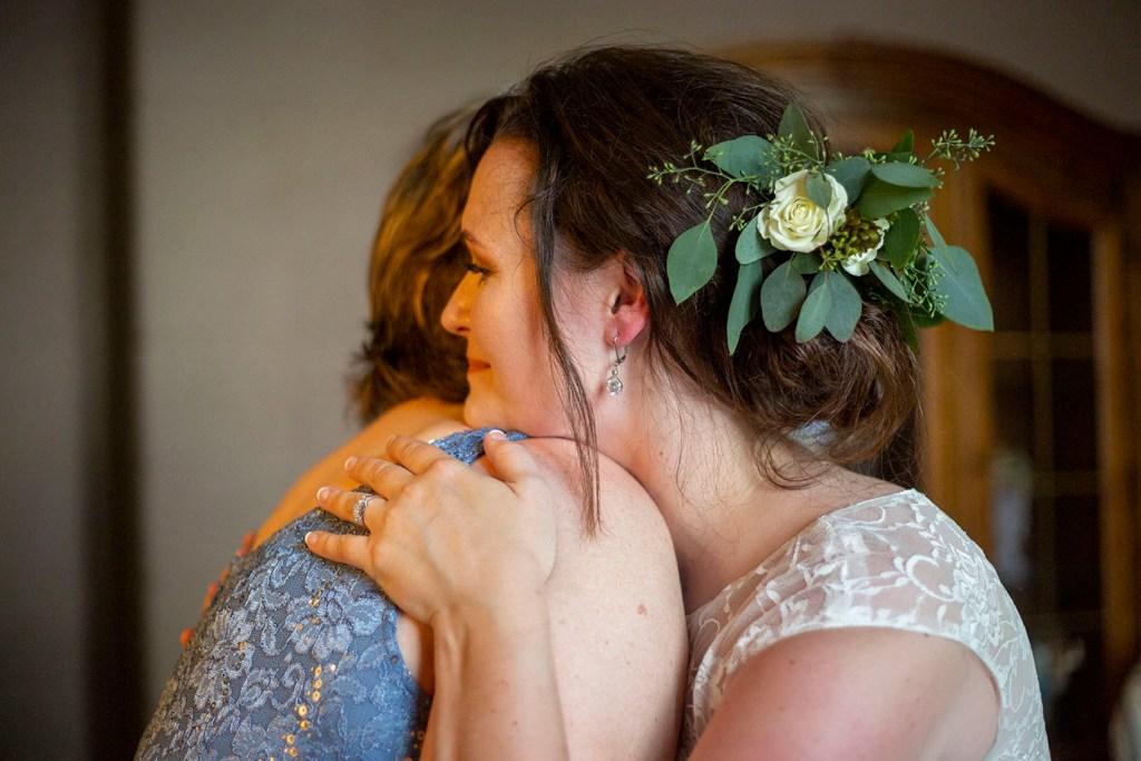 Mother hugging daughter before her Northville wedding