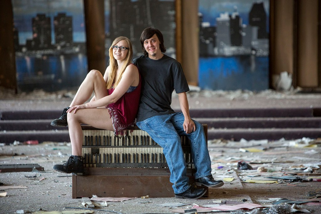 Detroit engaged couple sits on top of dilapidated piano