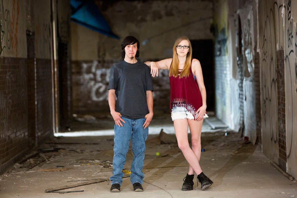 Couple poses in hallway during their Detroit urbex engagement session