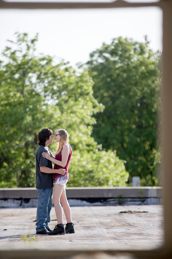 Michigan couple embraces during their engagement session