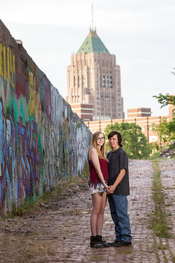 Michigan engaged couple with Detroit skyline in the background