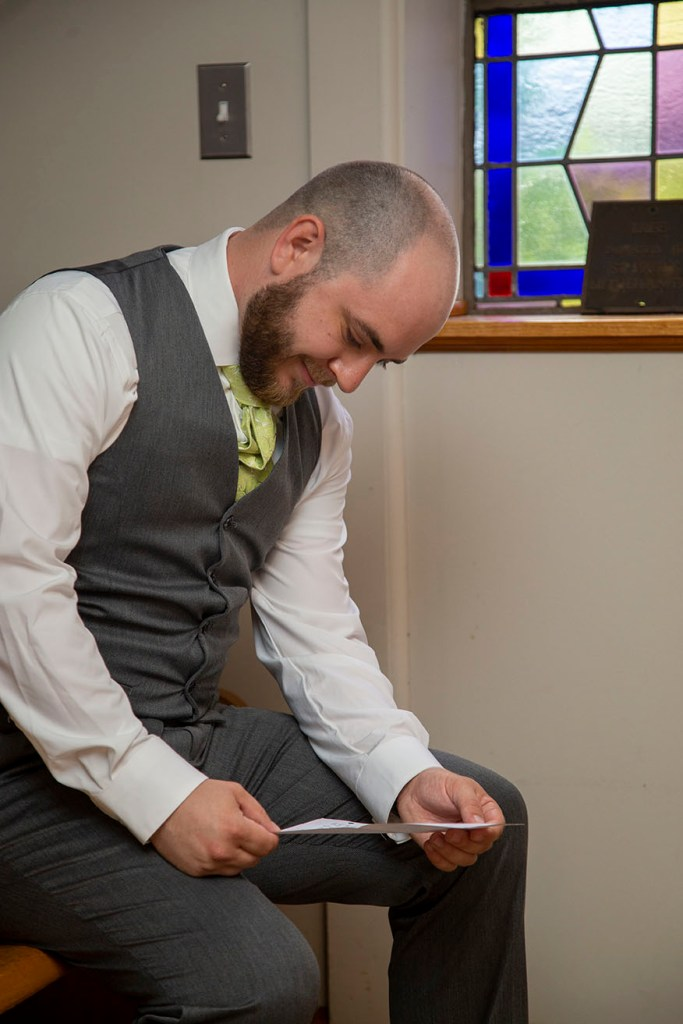 Groom reading letter from his bride
