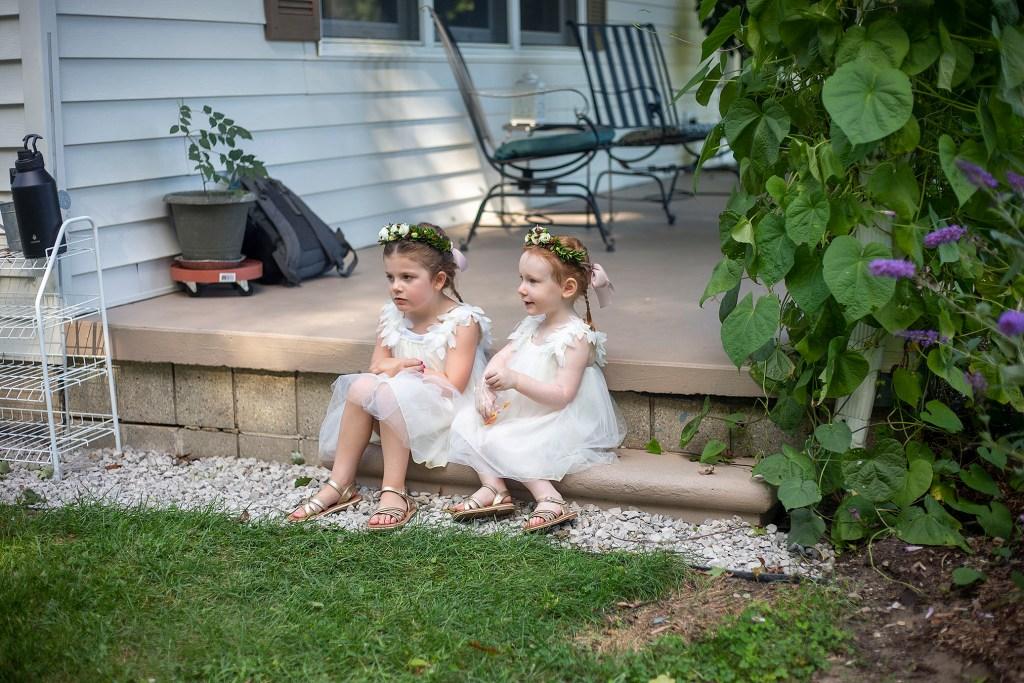Flower girls waiting before Belleville wedding ceremony