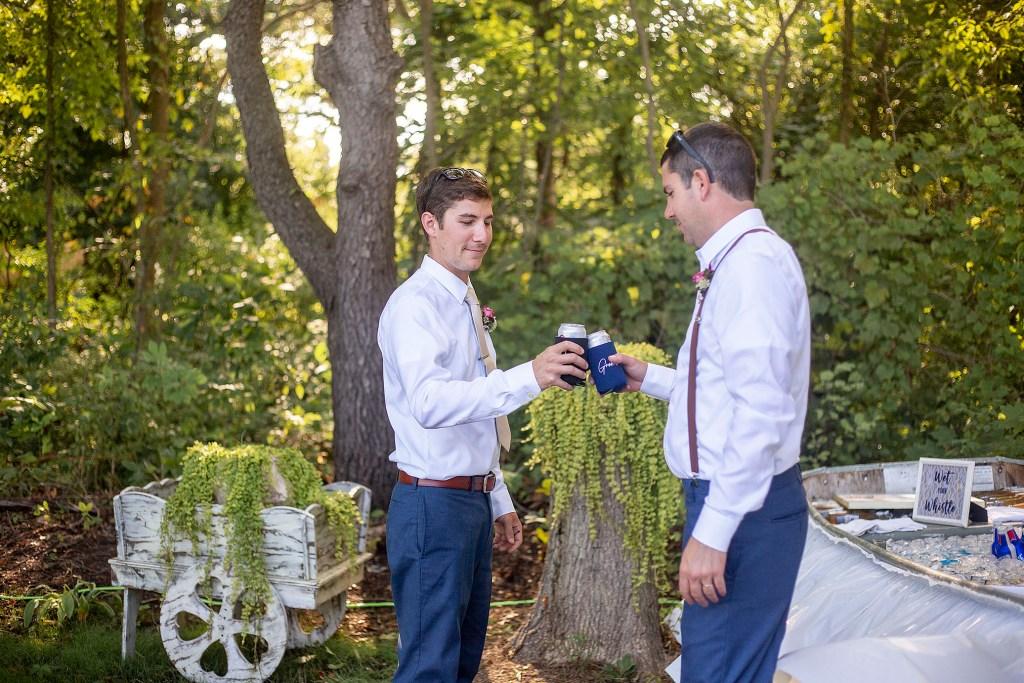 Groom and groomsman toasting
