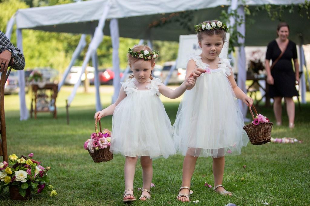 Flower girls walking down the aisle at Belleville wedding