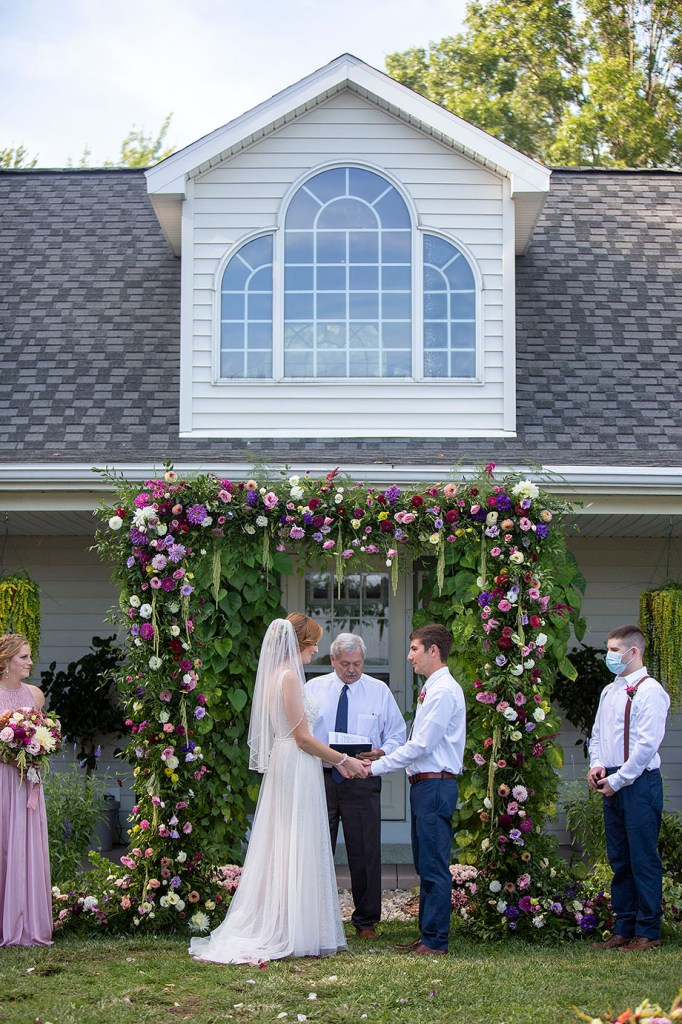 Couple holds hands at their Belleville wedding