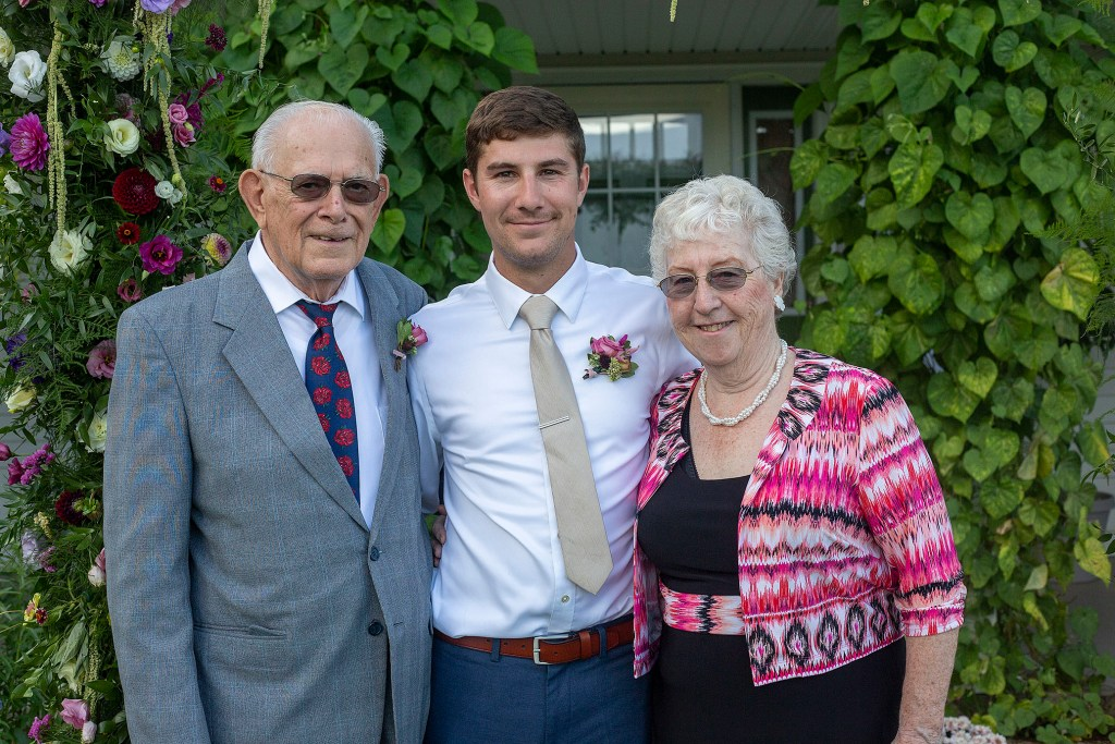 Groom and his grandparents