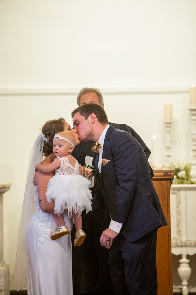 First kiss at All Saints Chapel Howell wedding