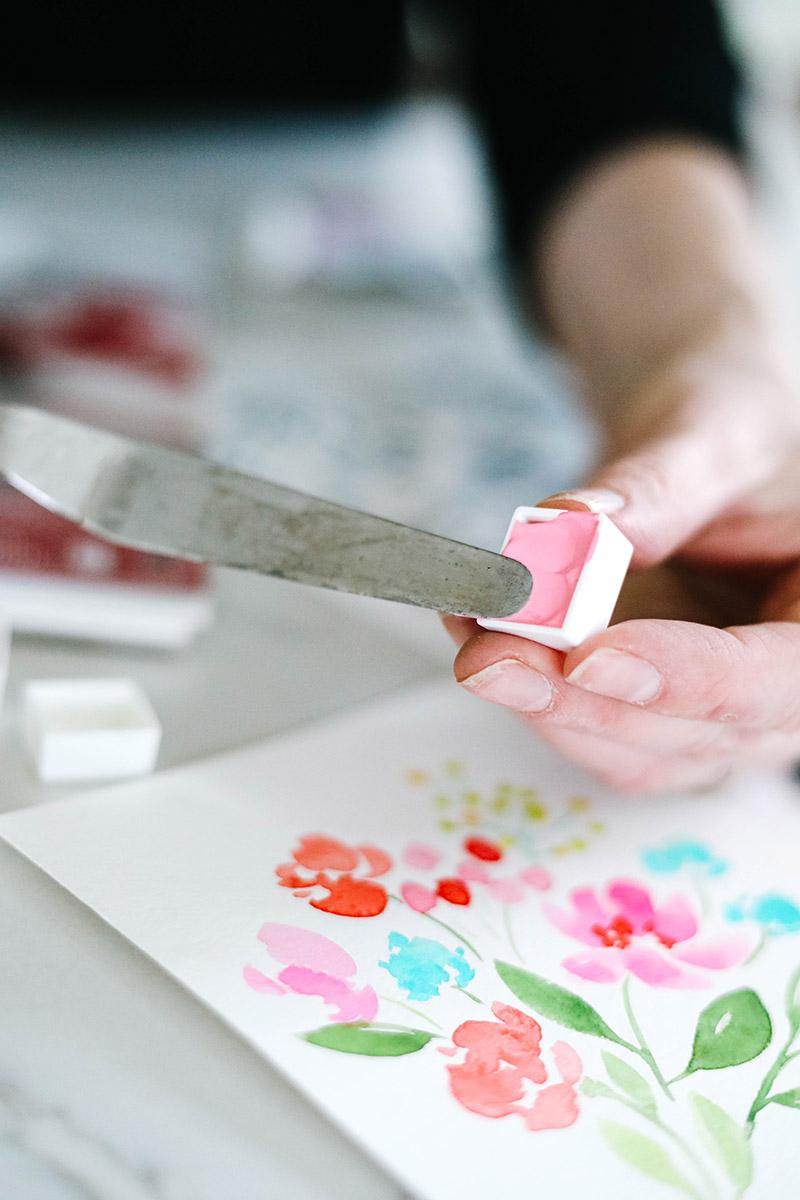 filling watercolor half pan