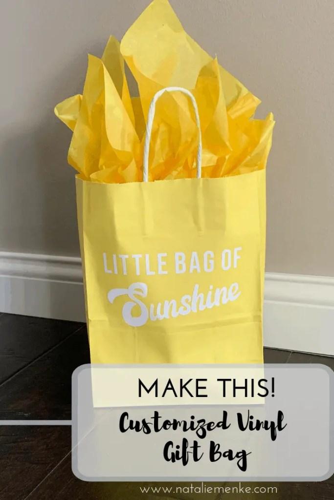 Make this customized vinyl gift bag using the Cricut tutorial at www.nataliemenke.com