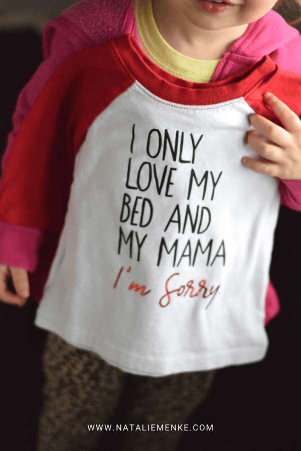 """Little girl holding up a Valentine's Day shirt with """"I Only Love My Bed and My Mama, I'm Sorry"""" text"""
