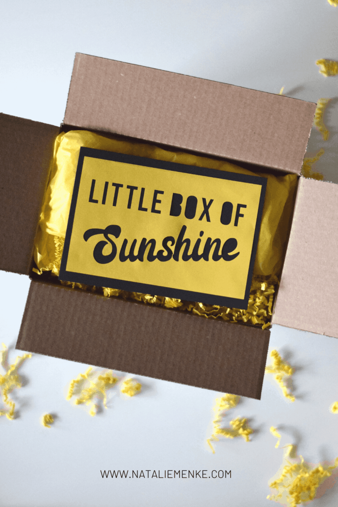 """cardboard box with """"Little Bag of Sunshine"""" note"""