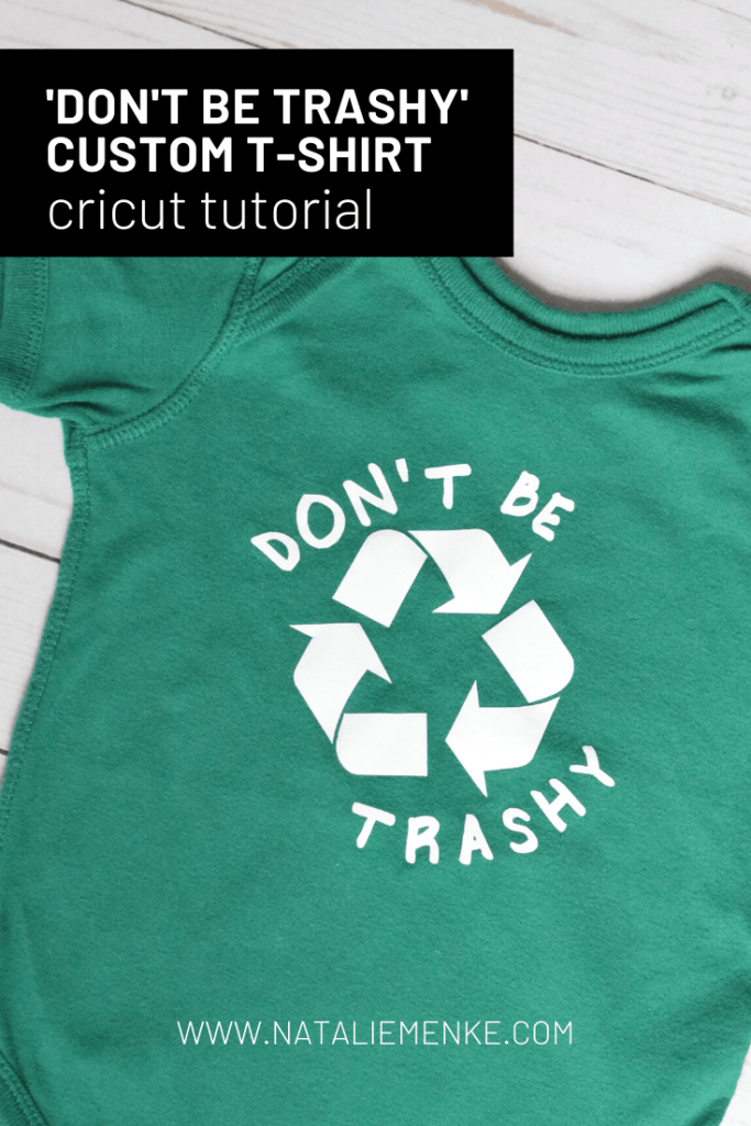 "green onesie with the words ""don't be trashy"" and a recycle symbol"