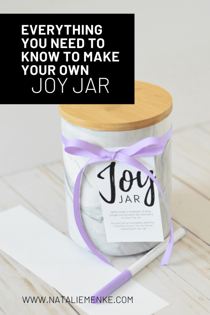 "Marble ""Joy Jar"" with instructions for making your own tied on with a purple ribbon"