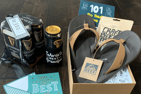 Grandpa Gift Box for Father's Day, including flip-flops, dad jokes book, and custom can cooler