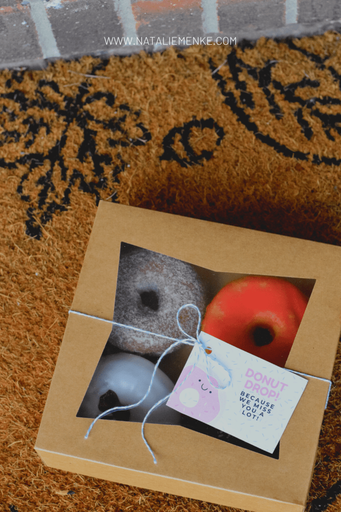 box of donuts and a 'Donut drop! Because we miss you a lot' gift tag
