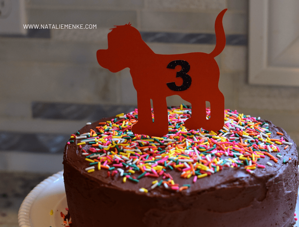 Clifford the Big Red Dog Cake topper on a chocolate cake