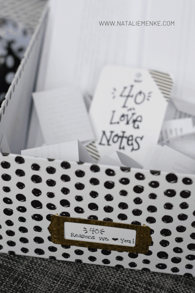 black and white polka dot box filled with 40 reasons we love you