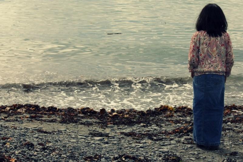 child-beach-water lost childhood