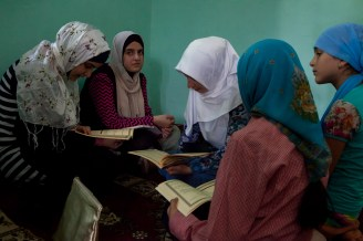 On the female half of the Mosque the girls gathered to study the Koran