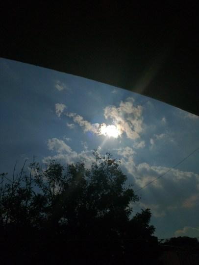 Noon sun through the winter sky