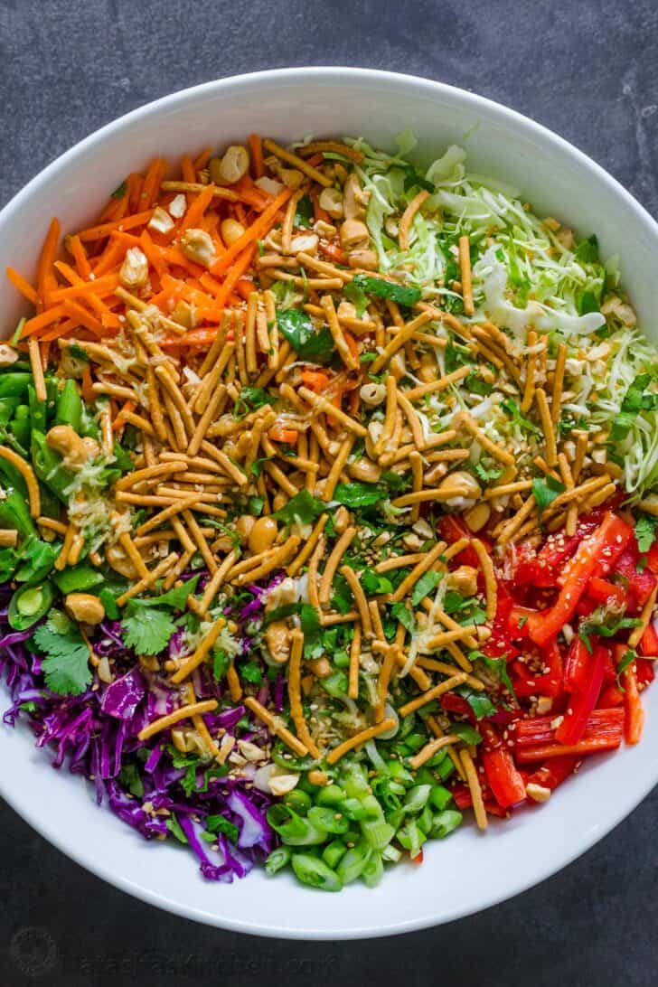 Asian Salad Ingredients layered in a salad bowl.