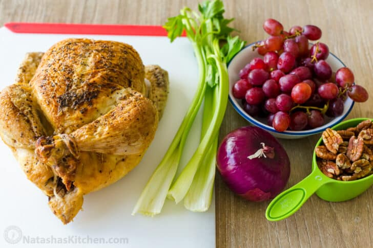 Ingredients for making chicken salad with fried chicken, celery, grapes, pecans and onions