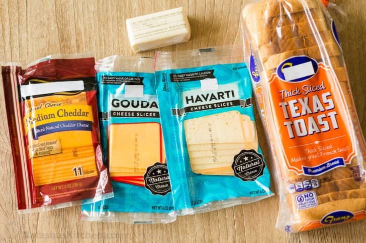 Ingredients for making grilled cheese with bread, sliced cheese and butter