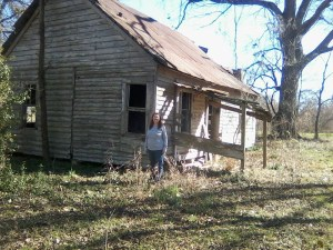 Judy Allen in front of her childhood home