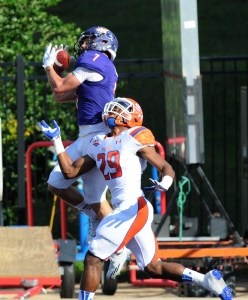 Northwestern State receiver Ed Eagan makes a catch over a Sam Houston defender during a 2014 game. (Gary  Hardamon)