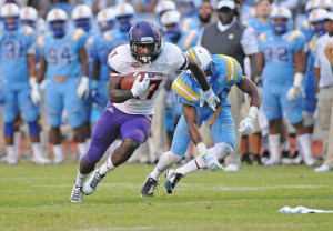 Northwestern State receiver Cody Jones runs away from a Southern defender during a 2014 game. (Gary Hardamon