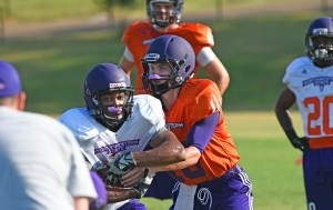 Junior quarterback Daniel Hazlewood hands to junior running back De'Mard Llorens