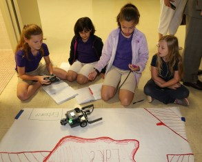Sadey Smith, Alana Ryder and Natalie Molina and Olivia Gillis, students in Jessie Church's science class at NSU Elementary Lab, programmed a robot to follow an obstacle course a part of Project Lead the Way Launch, implemented at the Lab School in January.
