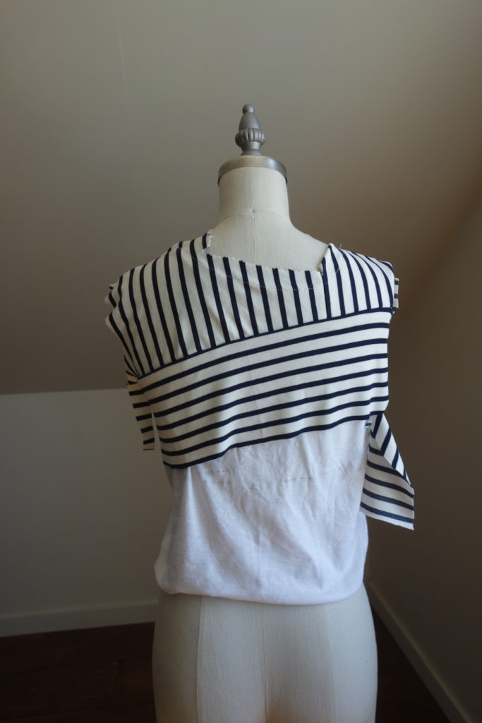 I had one long piece of stripe fabric and wanted to make a striped dress. To make my stripe dress unique I ran the stripes in different directions.