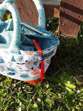 Lien coulissant pour fermeture d'un sac enfant. Bayonne (64)