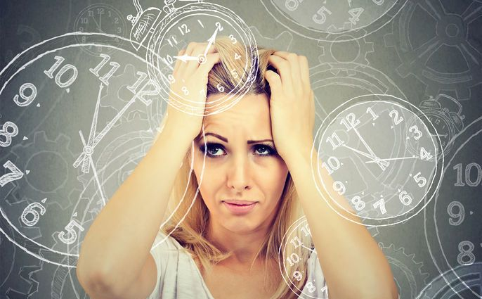 woman is overloaded and burden by the tasks, priorities, and stresses of life