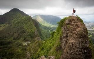 man atop a mountain