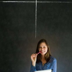 woman in front of chalkboard with pros and cons
