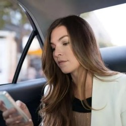 uber-woman-ride-in-the-back-seat